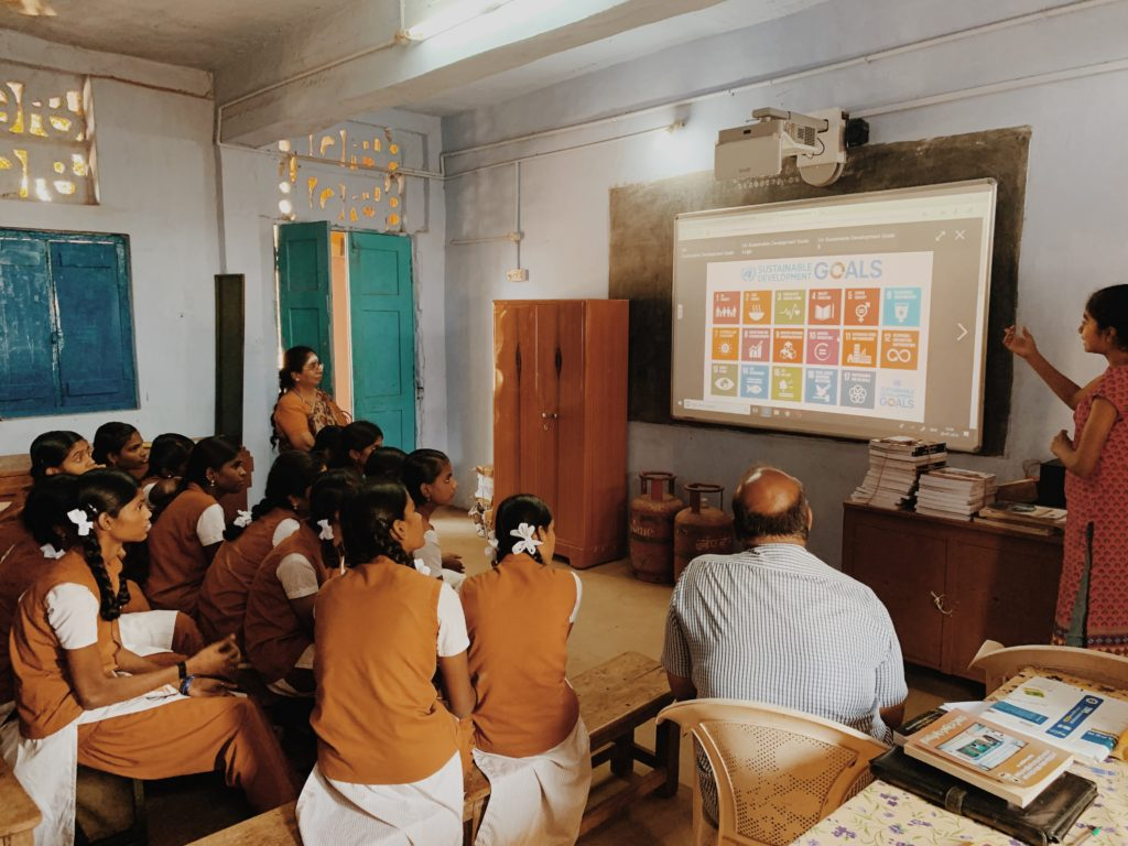 Shiva leading an education session in India